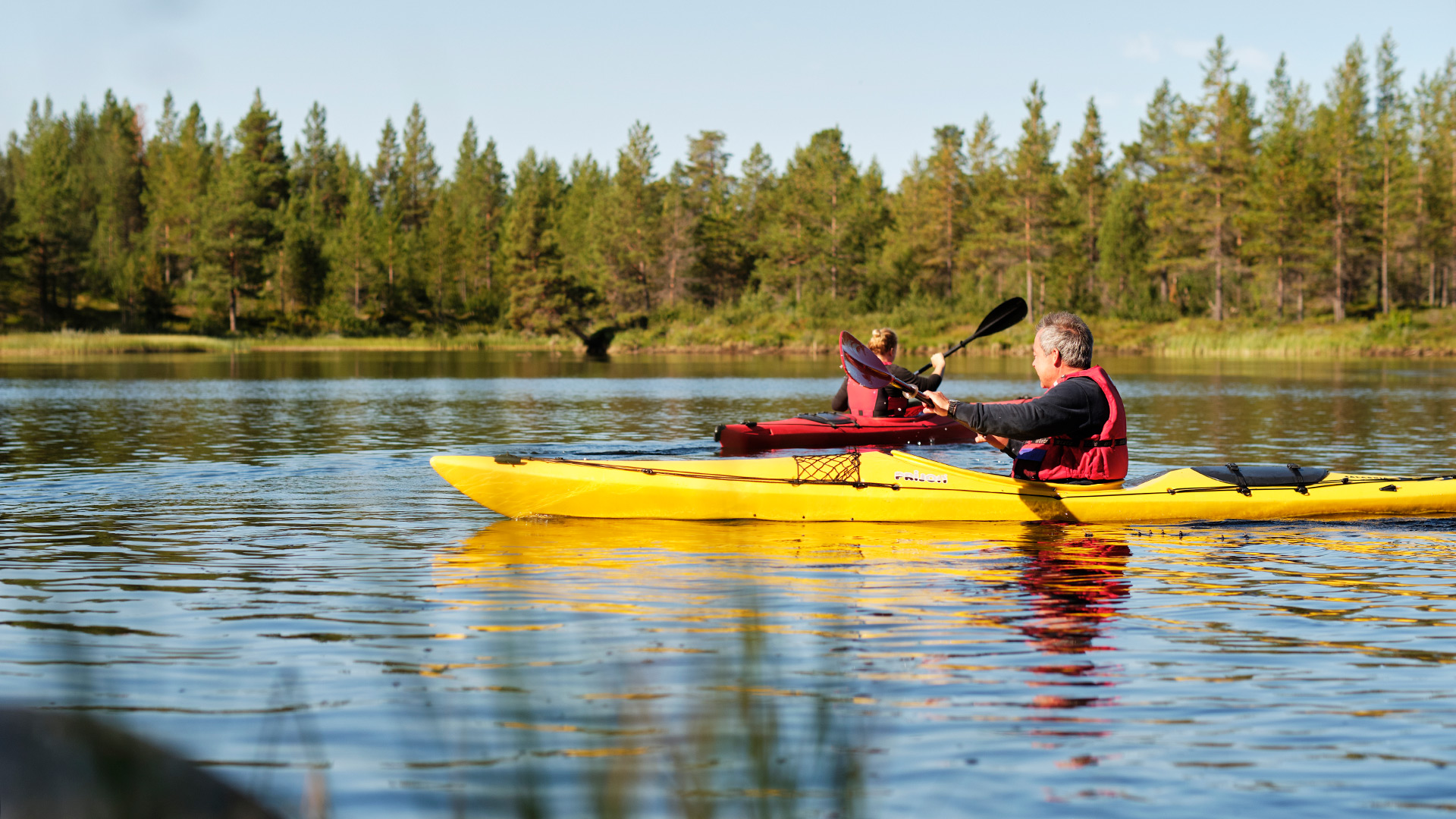 Person paddling a canoe.